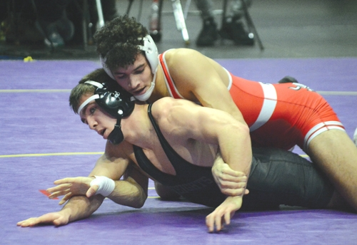 Julian Fletcher, a Huntington North High School senior, wrestles at the semi-state wrestling competition that took place on Saturday, Feb. 13. Fletcher made it to the second round of competition, but fell short of making it to the state finals.