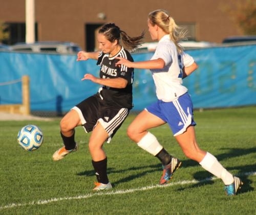 Huntington North defender Courtney Scher maneuvers with the ball against a Homestead foe during action in the Homestead Girls' Soccer Sectional championship game on Thursday evening, Oct. 10. The Lady Vikings lost, 4-0.